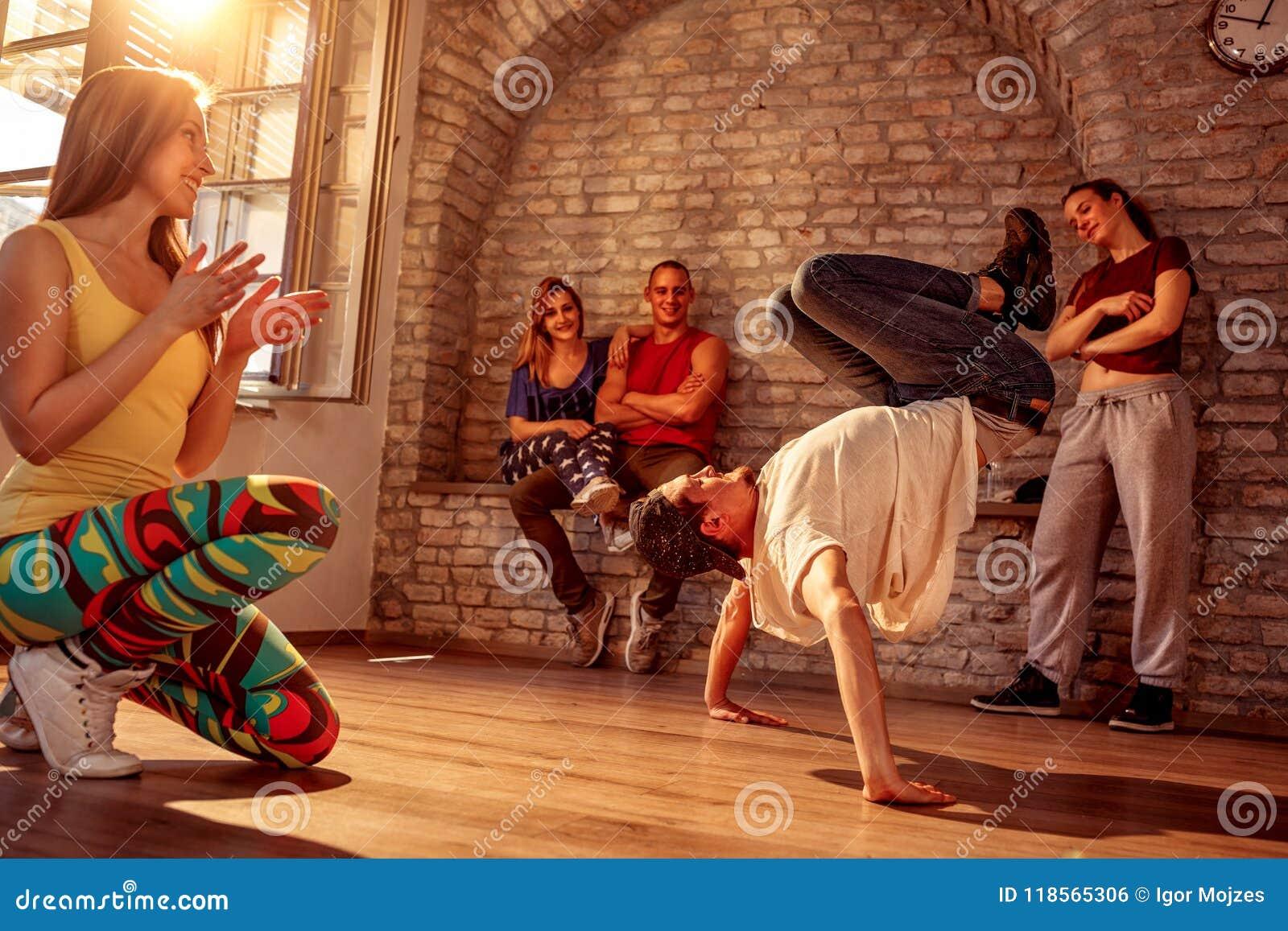 Young street artist break dancing performing moves