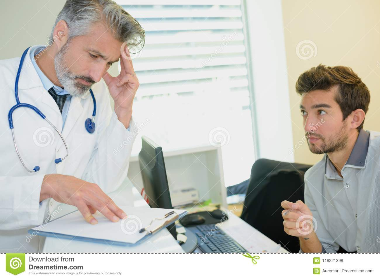 Young stressed male patient consulting with doctor