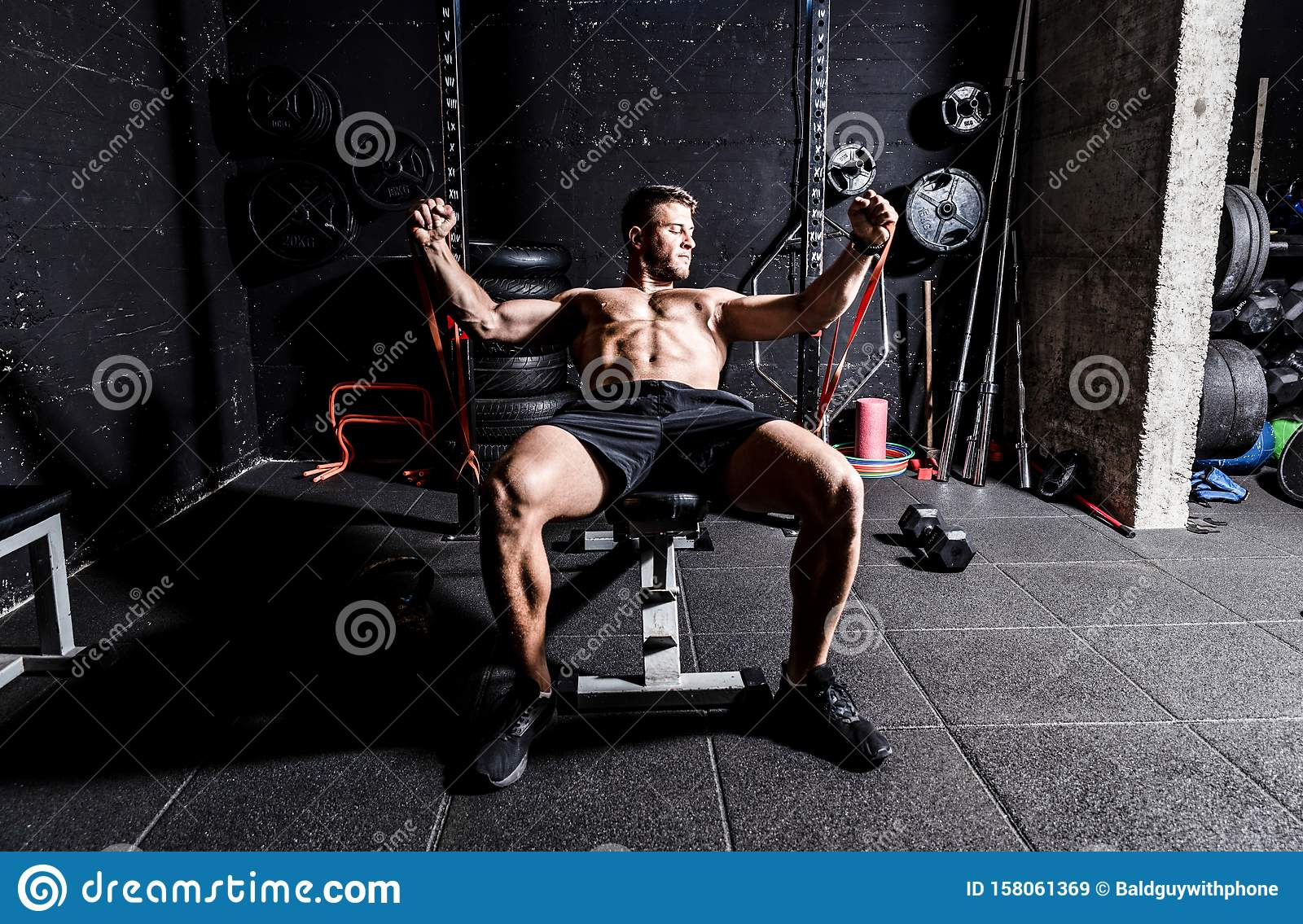 Young Strong Focused Fit Muscular Man Chest Bench Press Stretching Workout Training In The Gym With Rubber For Strength And Good L Stock Image Image Of Chest Bodybuilding 158061369
