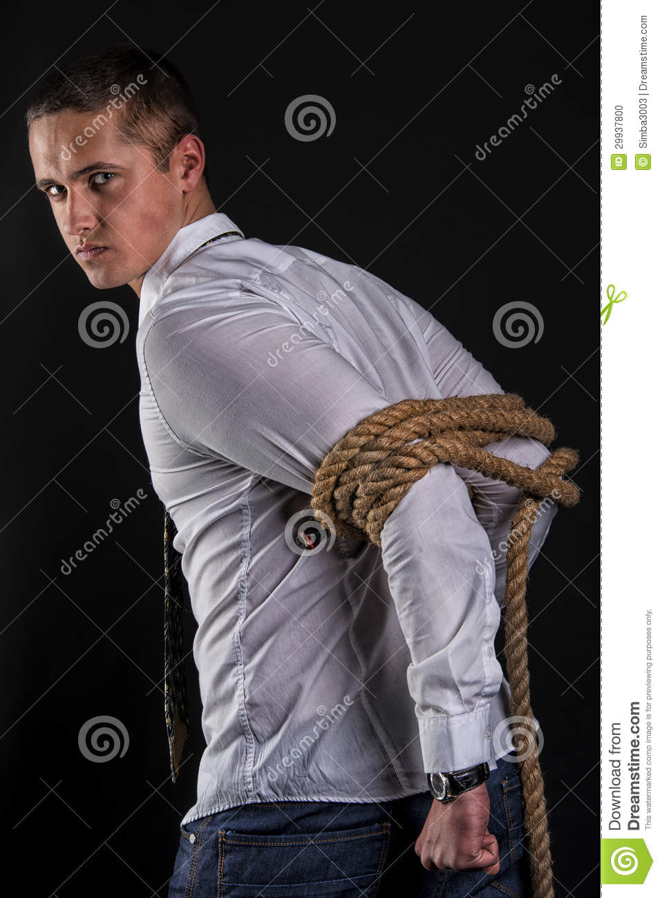Young Beautiful Man Tied Up With Rope Stands Sideways