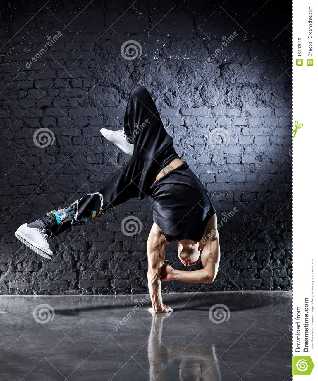 Young strong man break dance