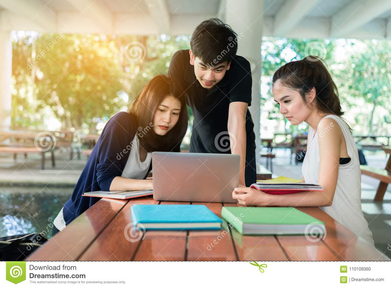 Young Students Group Consult with School Folders,Laptop Computer