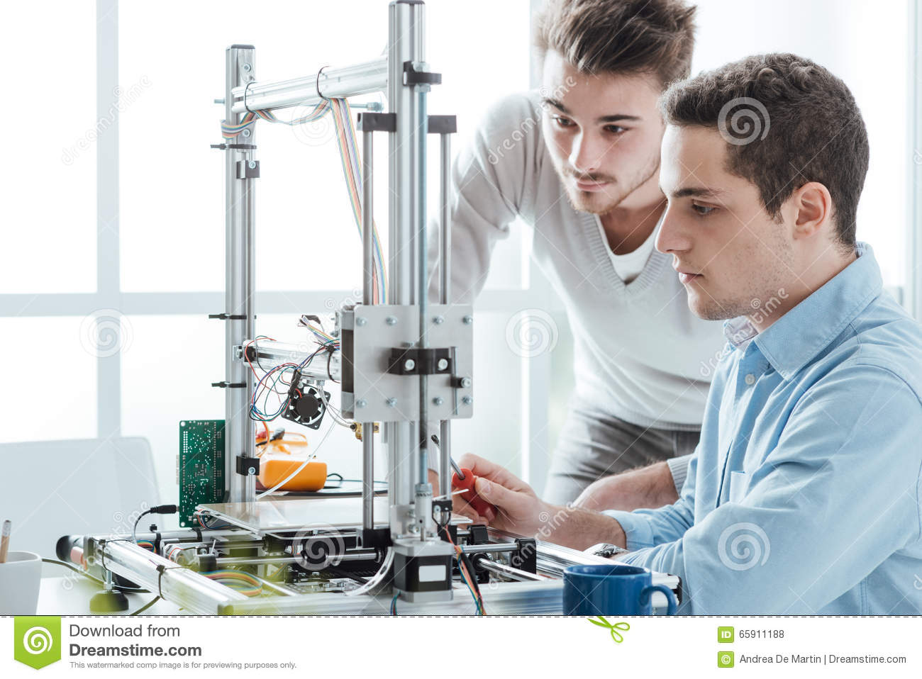 Young students using a 3D printer