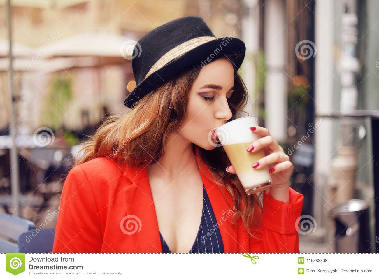 1615467bb6d7 Young Stylish Beautiful Woman Sitting In City Cafe In Red Jacket ...