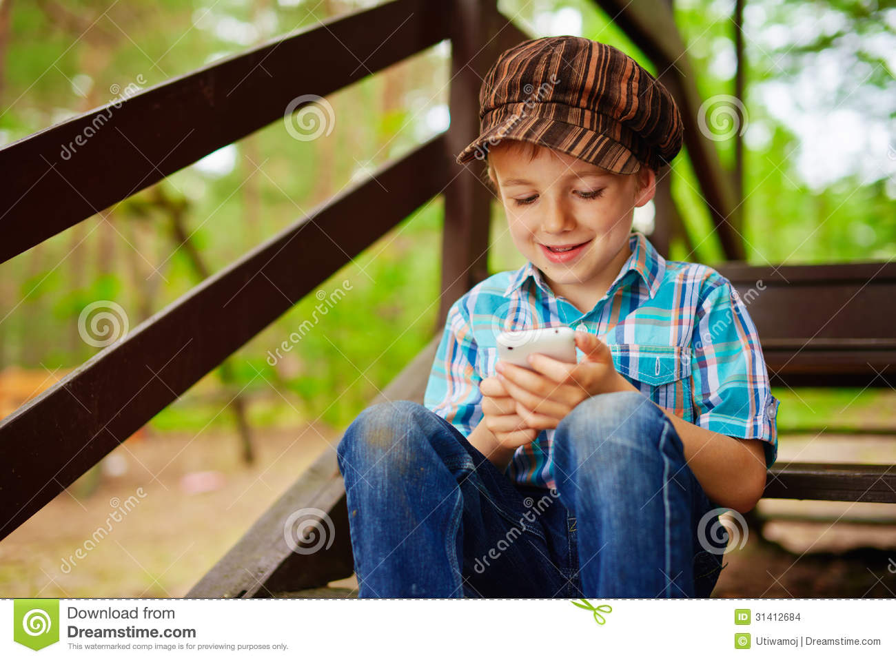 Young boy browsing mobile internet on phone stock photo for Mobel stylisch