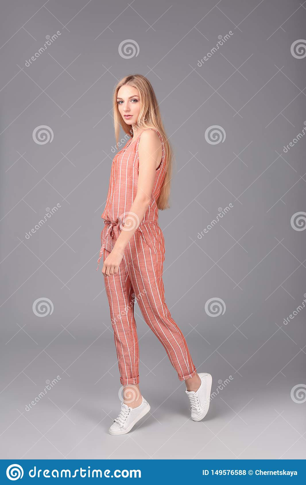 Young stylish woman in trendy sport shoes