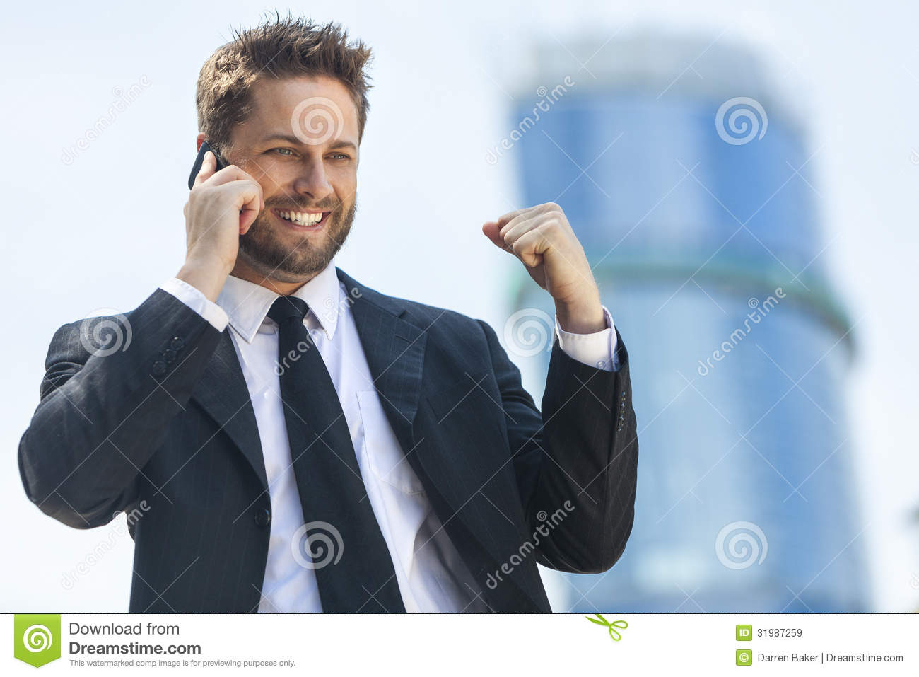 young-successful-business-man-talking-cell-phone-male-executive-businessman-his-mobile-celebrating-front-high-rise-31987259.jpg