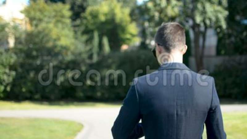 Young Businessman Walking Forward In A Hurry To Job Interview Or Meeting Back To Camera