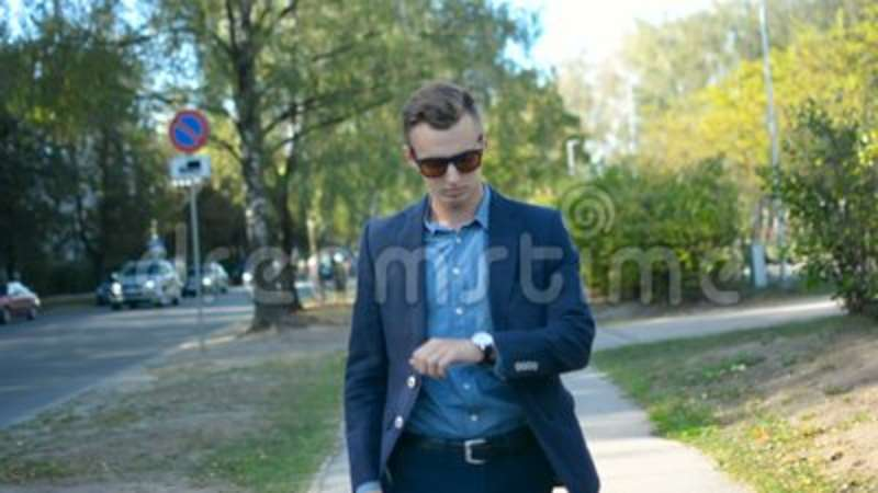 Young Businessman Walking Forward In A Hurry Towards His Bright Future Concept Facing Camera