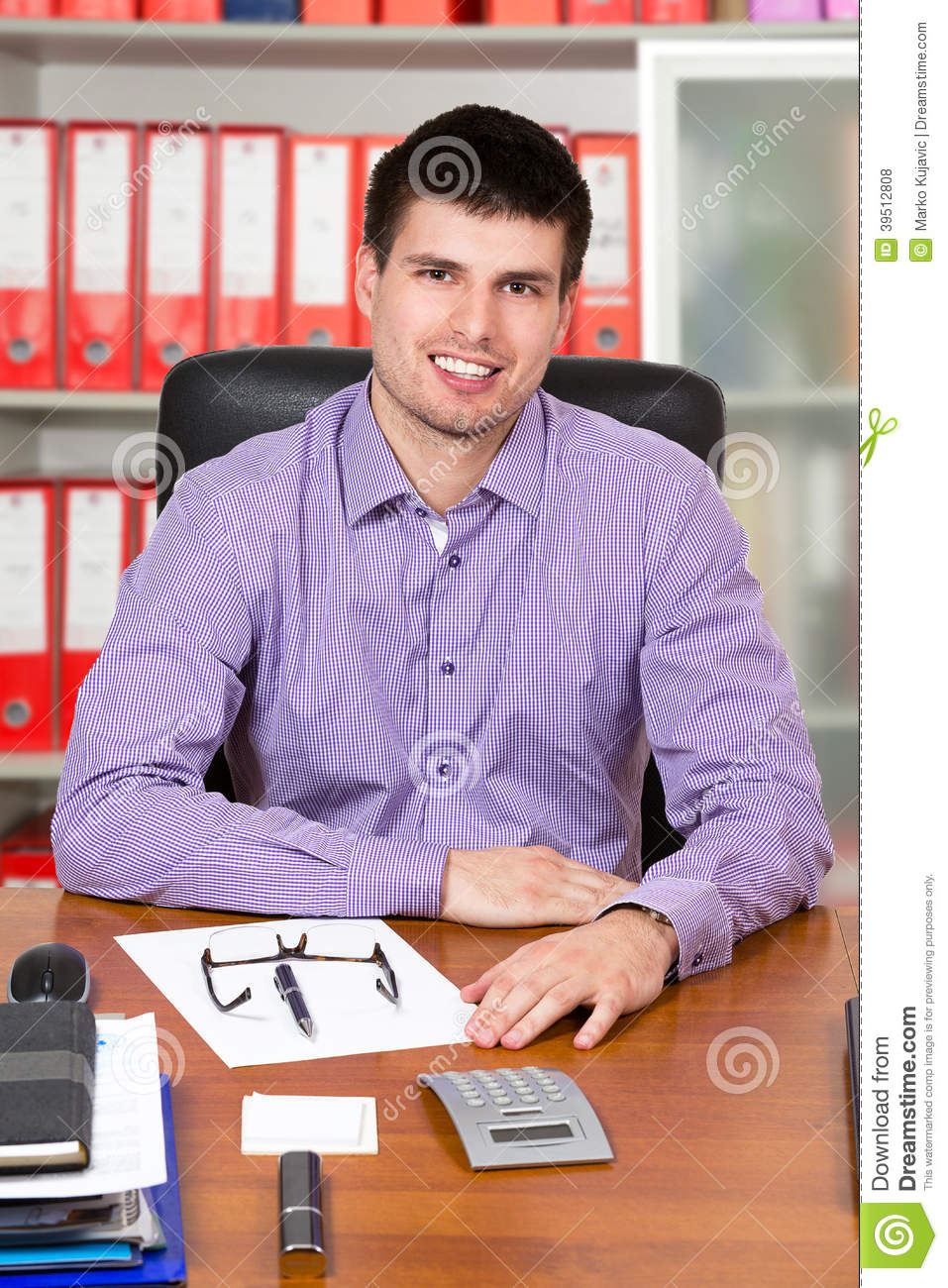 Young successful businessman working on his desk