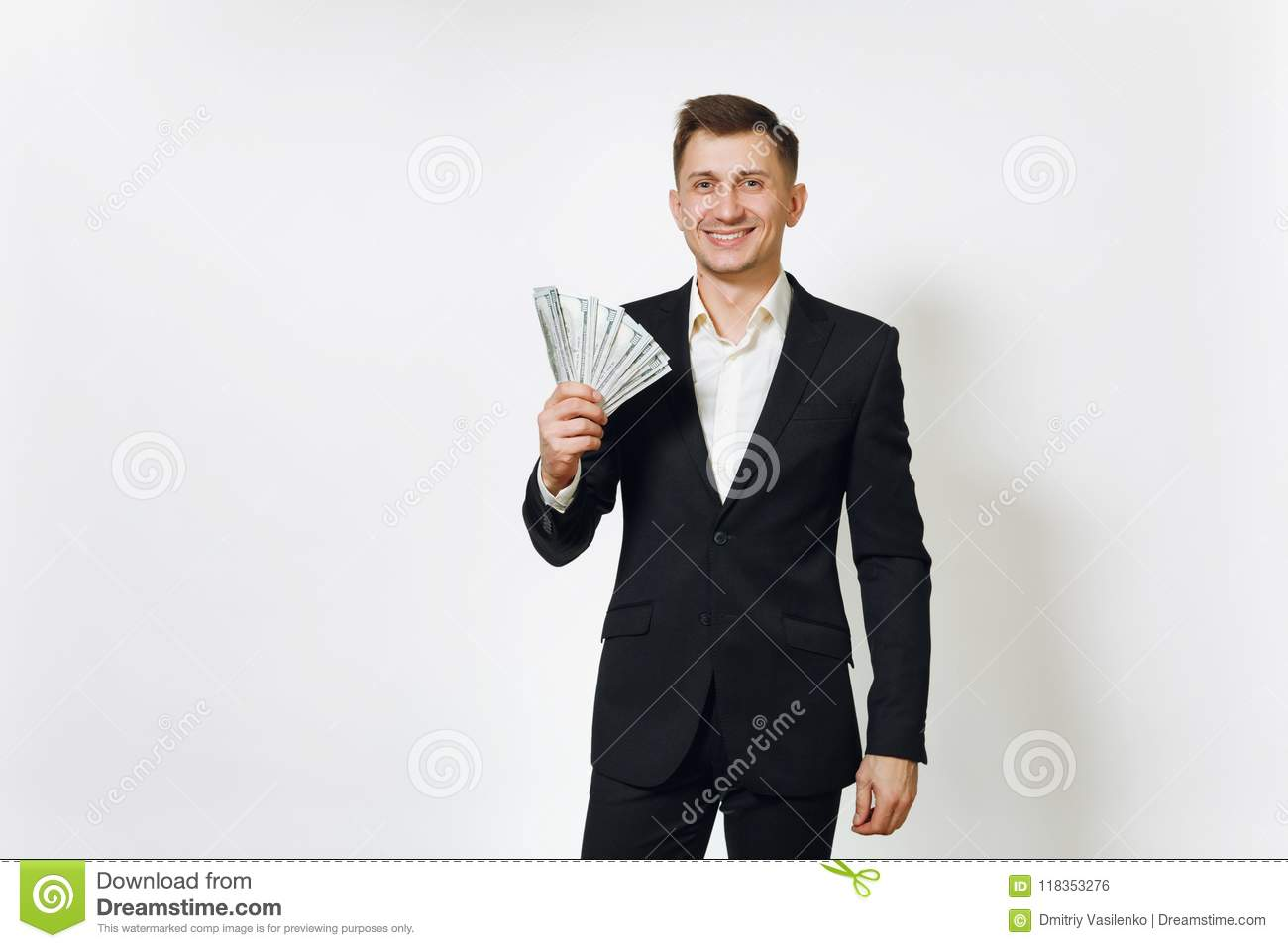Young successful handsome rich business man in black suit on white background for advertising.