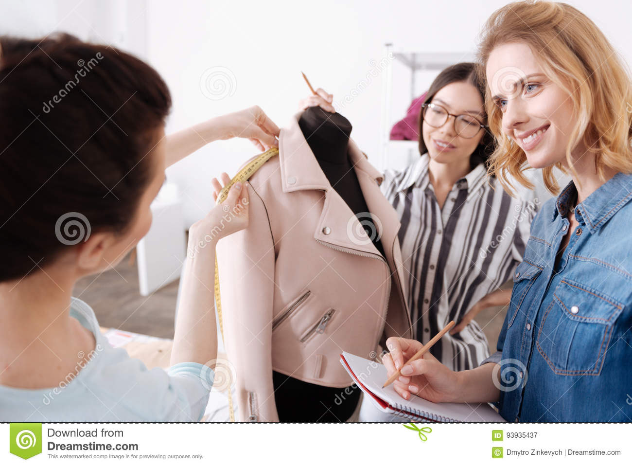 Young Tailors Working With A Pink Jacket Stock Photo - Image: 93935437