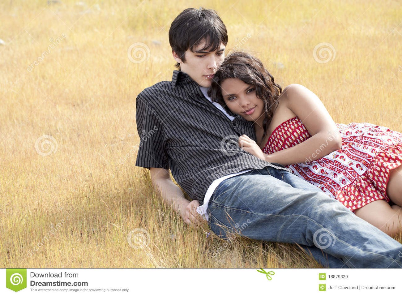 Young Teen Couple Reclining In Yellow Grass Royalty Free -9389