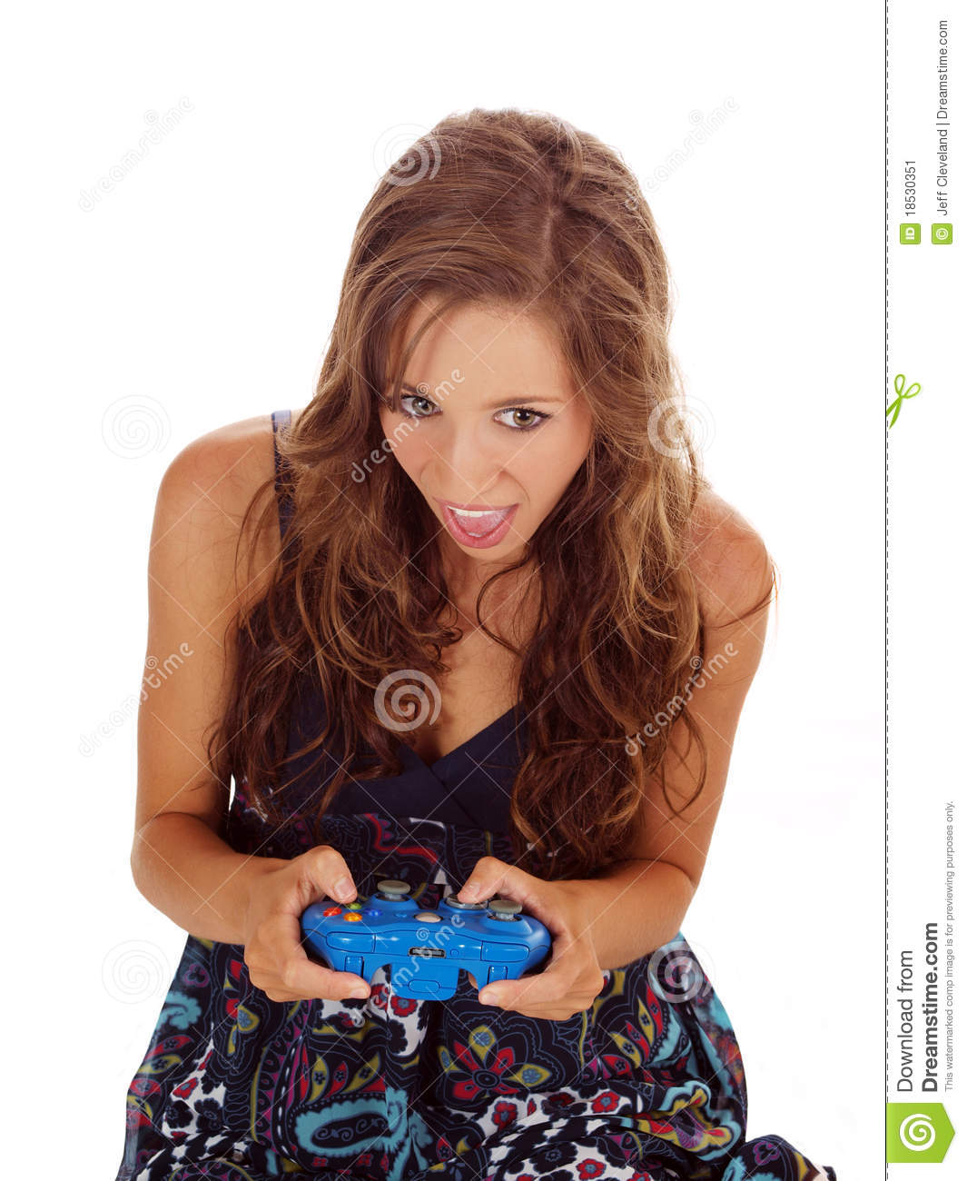 Young teen girl with game controller mouth open
