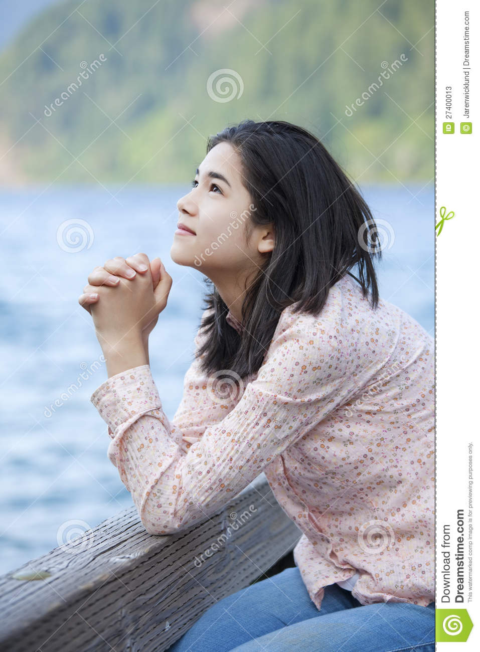 A Young Teen Girl With Long Curly Blond Hair Is Outside: Young Teen Girl Praying Quietly On Lake Pier Stock Photos