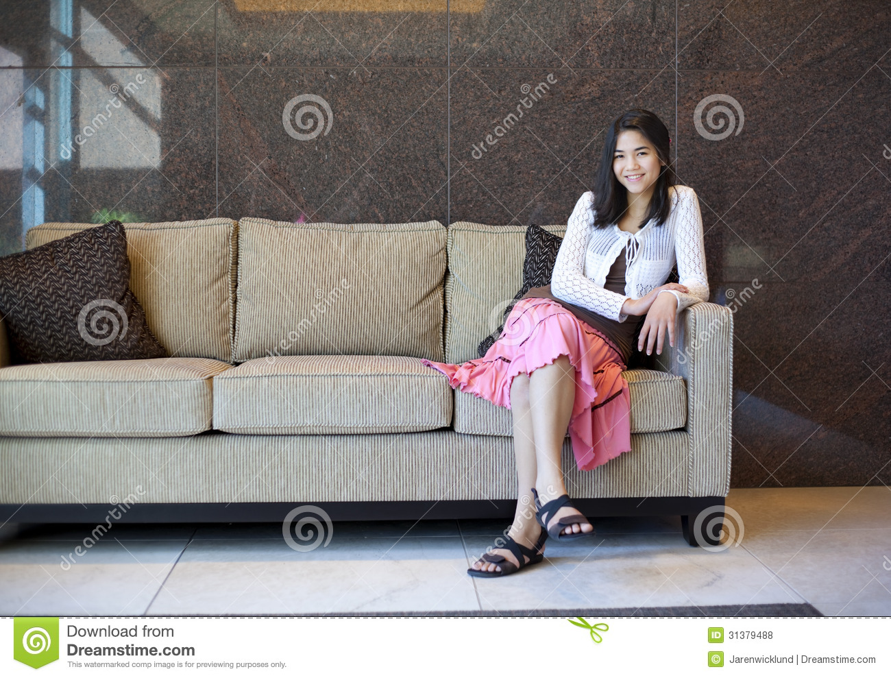 Young teen girl resting on an elegant couch