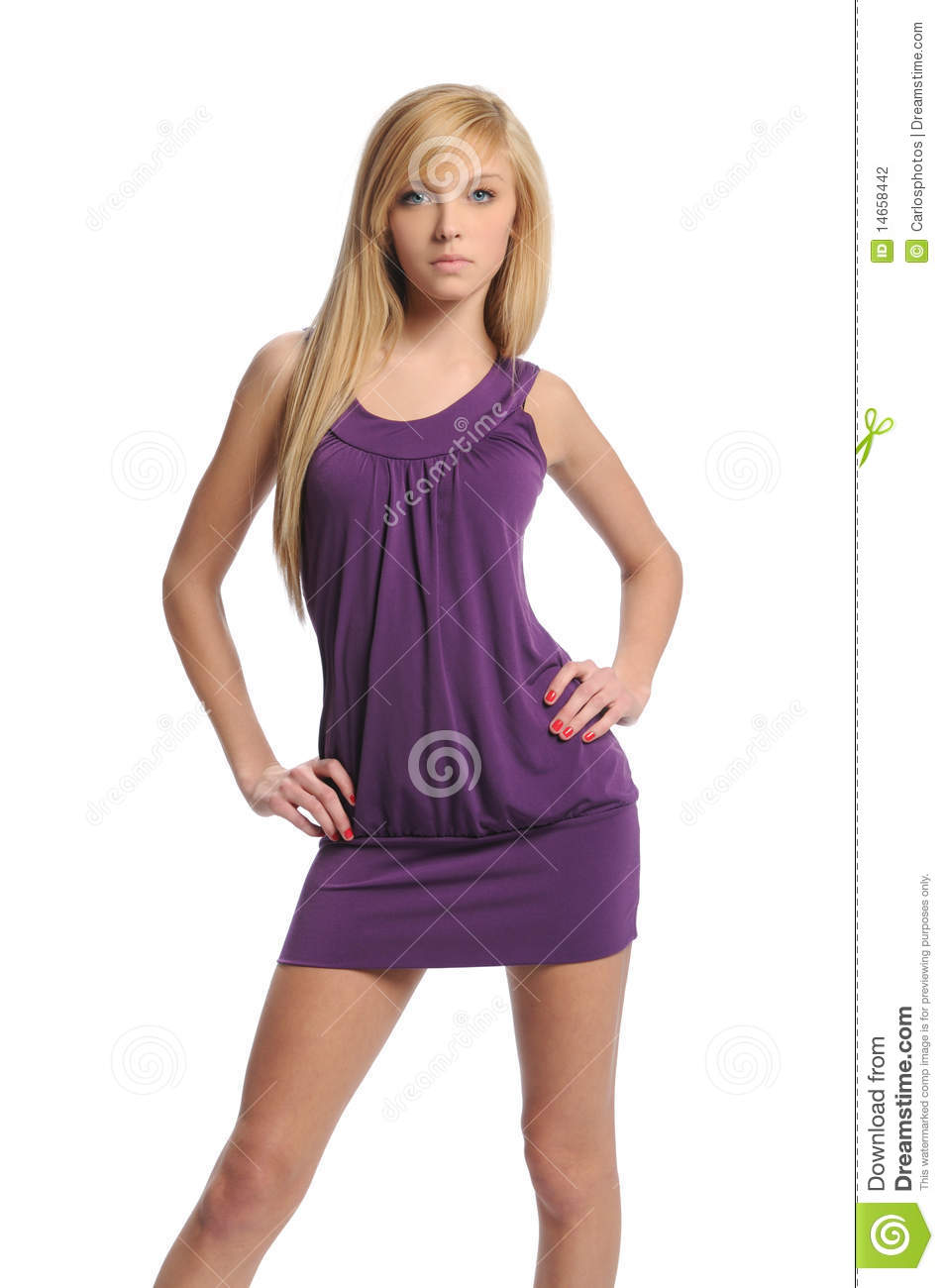 Young teen woman wearing a purple dress posing isolated on a white ...