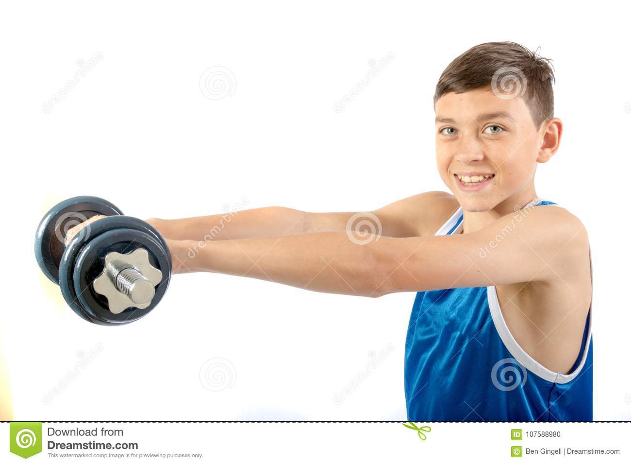 young teenage boy using dumbbells stock photo image of power