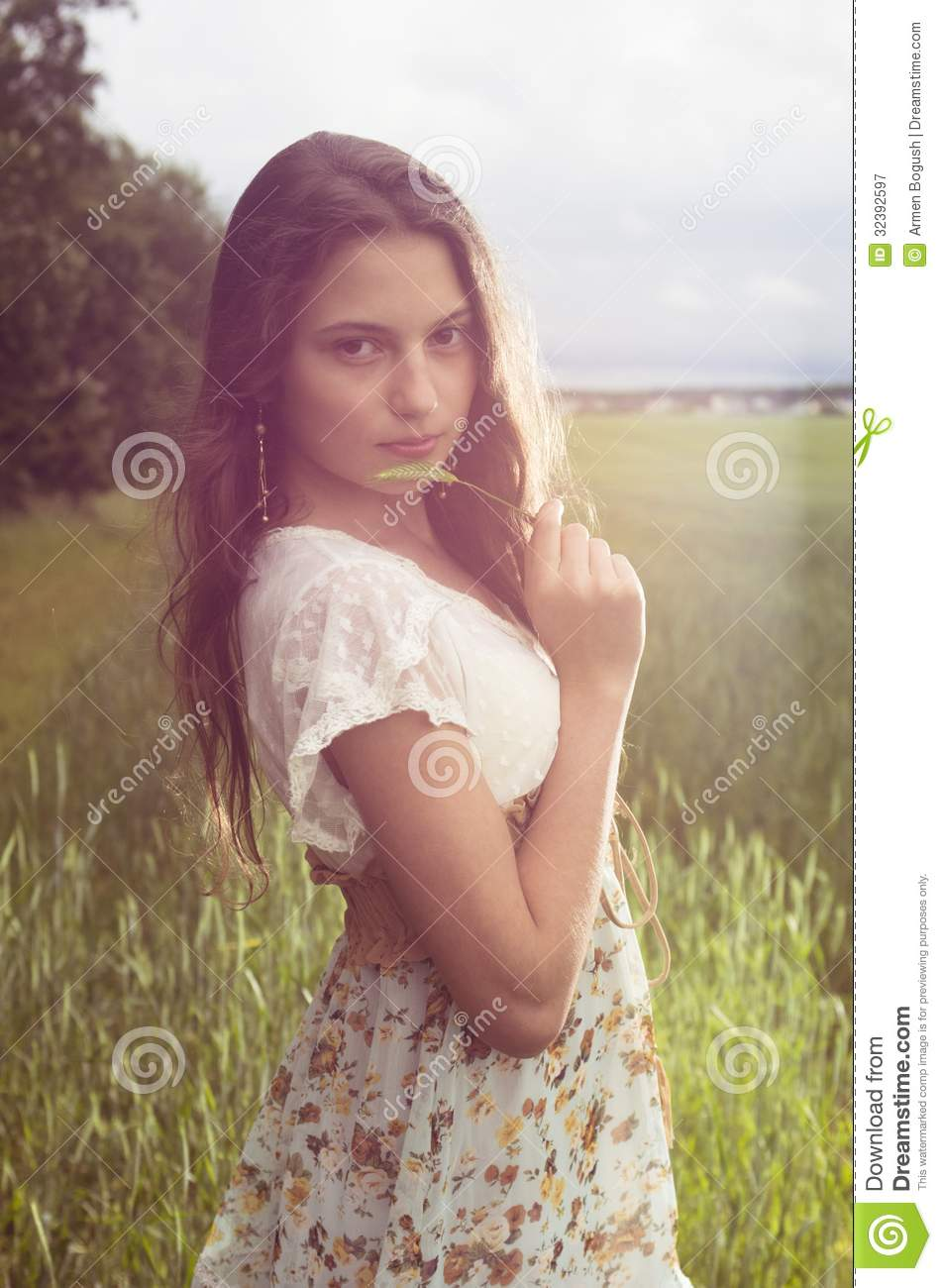 Young Teenage Girl At The Field Royalty Free Stock