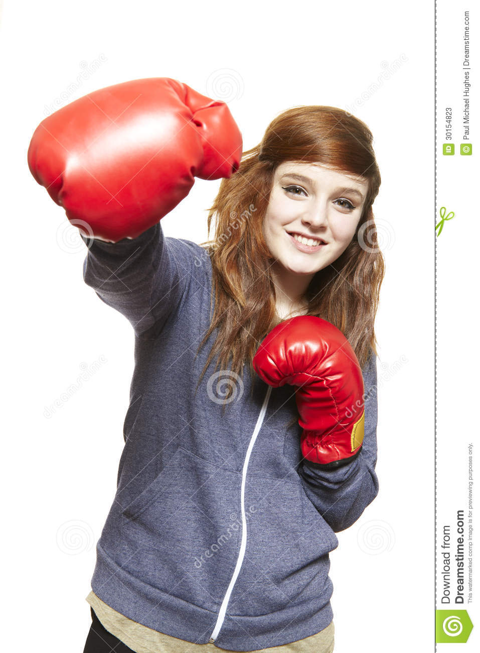 Young teenage girl wearing boxing gloves smiling