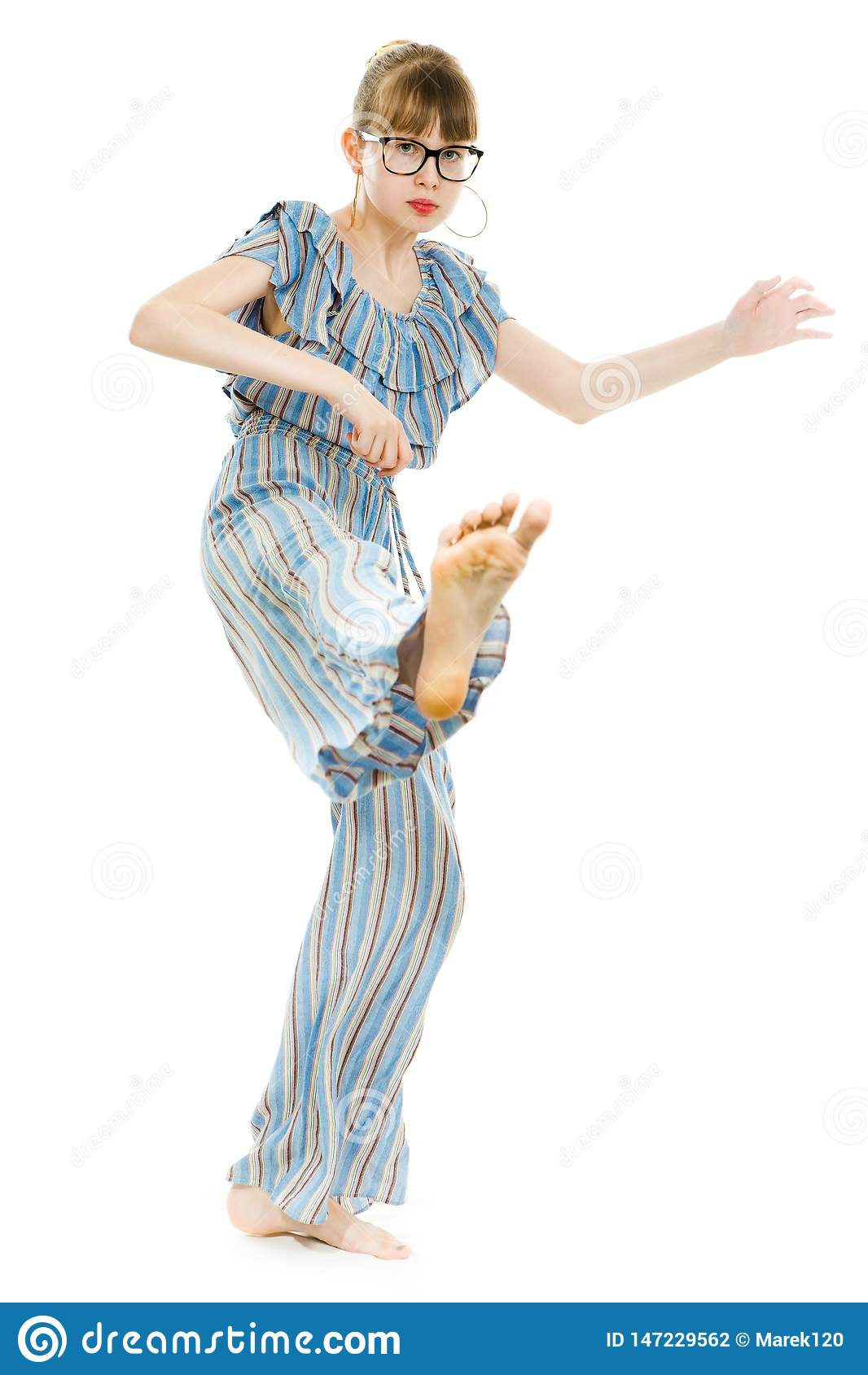 Young teenaged girls wearing jumpsuit dress with gaps texture - direct kicks