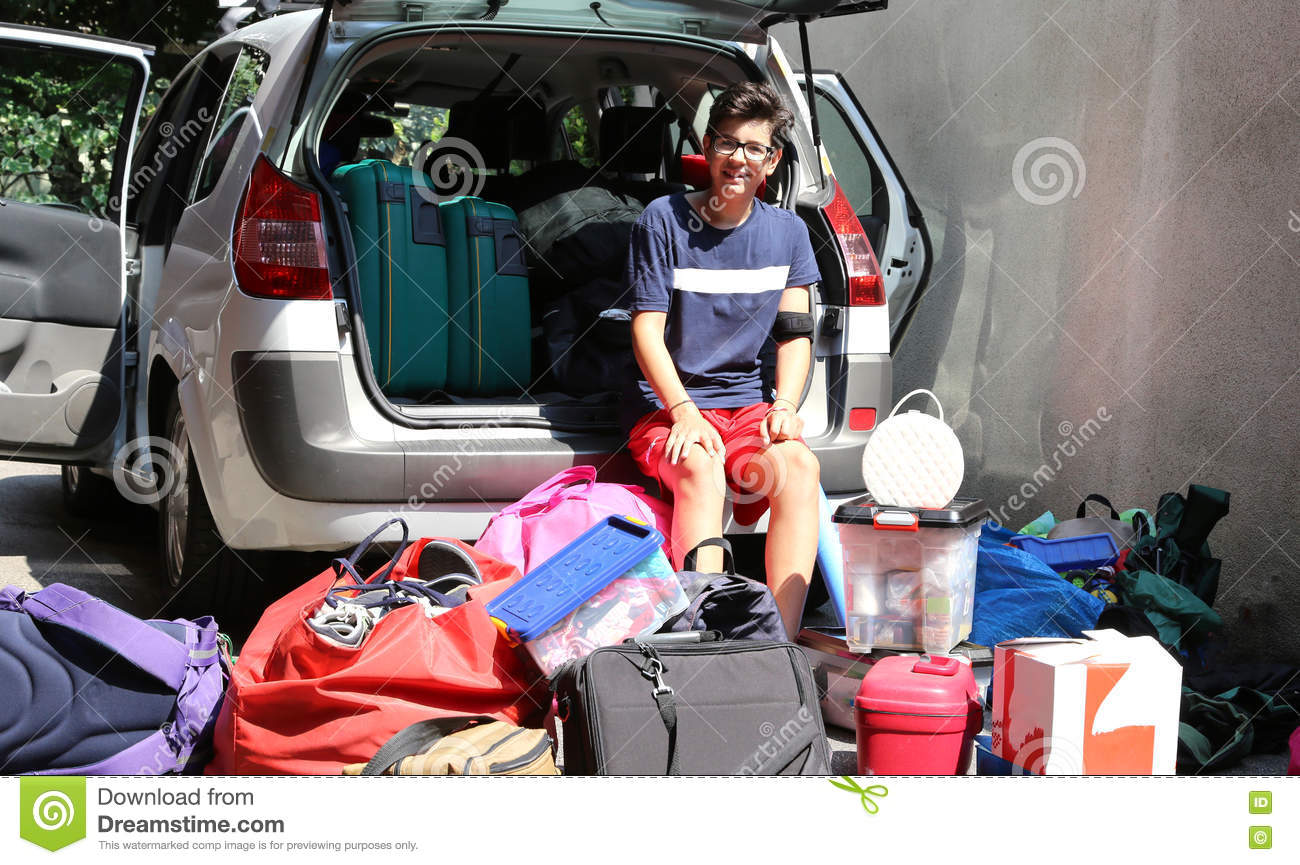 young teenager sitting on the car with a lot of luggage stock image image 78603213. Black Bedroom Furniture Sets. Home Design Ideas