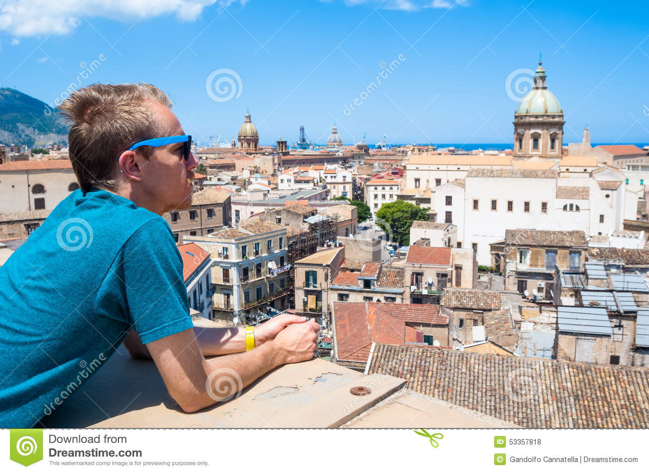 Young tourist observes the city of Palermo from above