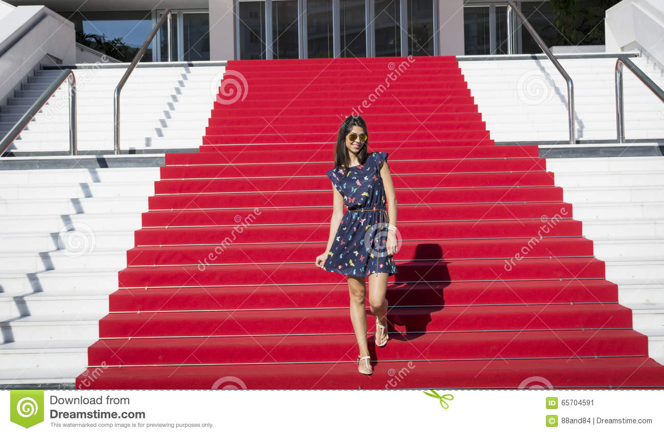 Young tourist woman on the Red carpet in Cannes, France. Stairs of fame