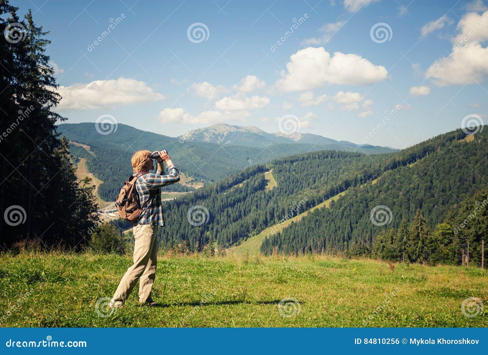 Download Young Traveler Enjoying Mountain View Stock Photo - Image of activity, walk: 84810256
