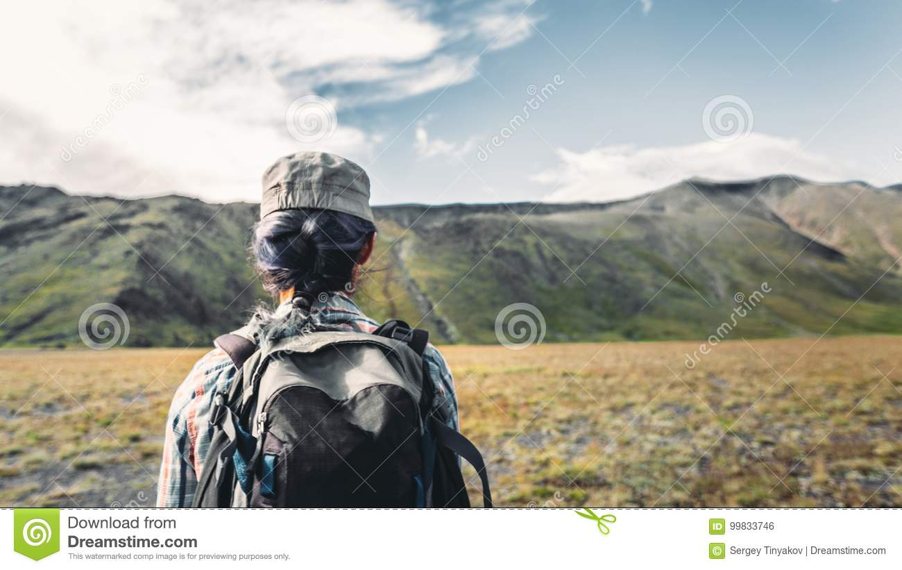 Young Traveler Girl With Backpack Is Engaged In Hiking In Mountains, Rear View. Tourism Adventure Lifestyle Concept