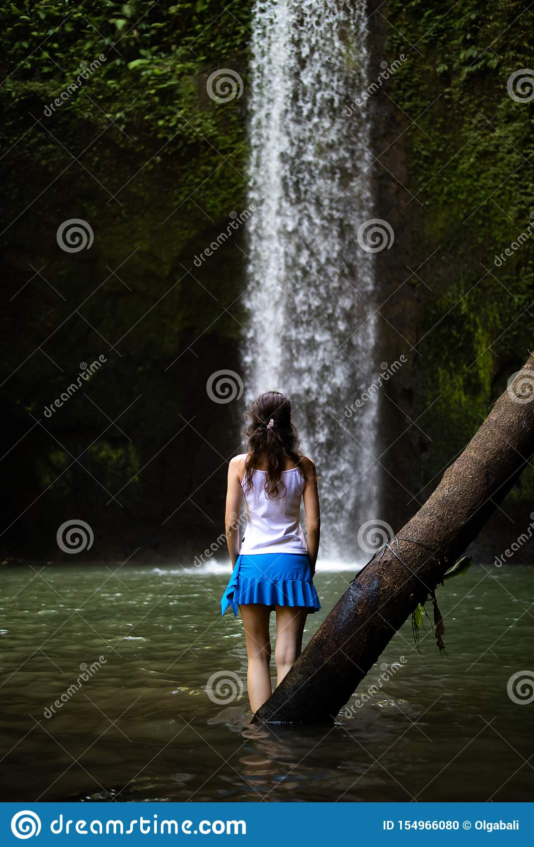 Woman Sitting on Rock on Top of Waterfalls · Free Stock Photo