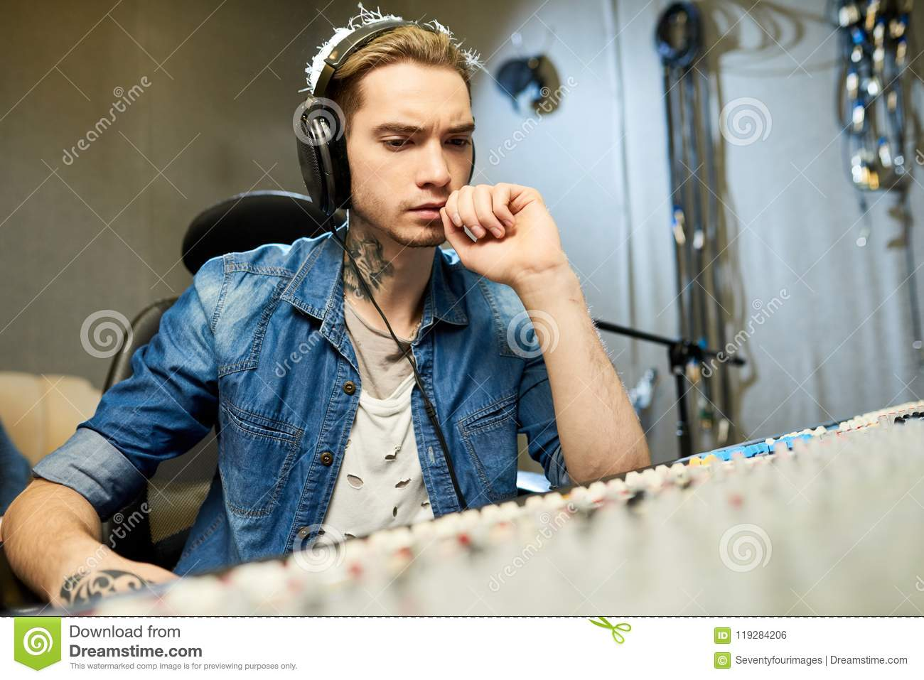 Musician listening to song recording