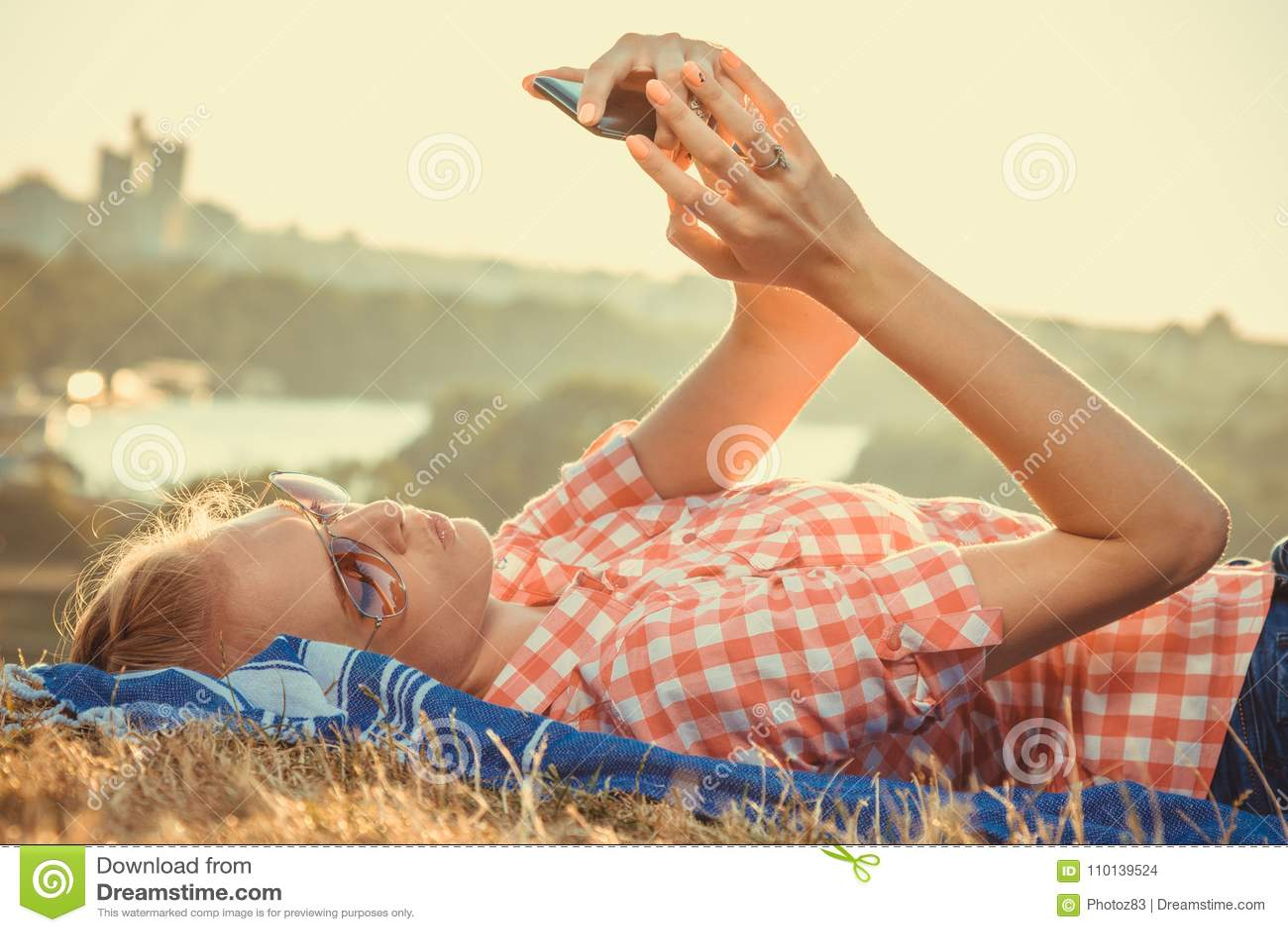 Female taking selfie on the field