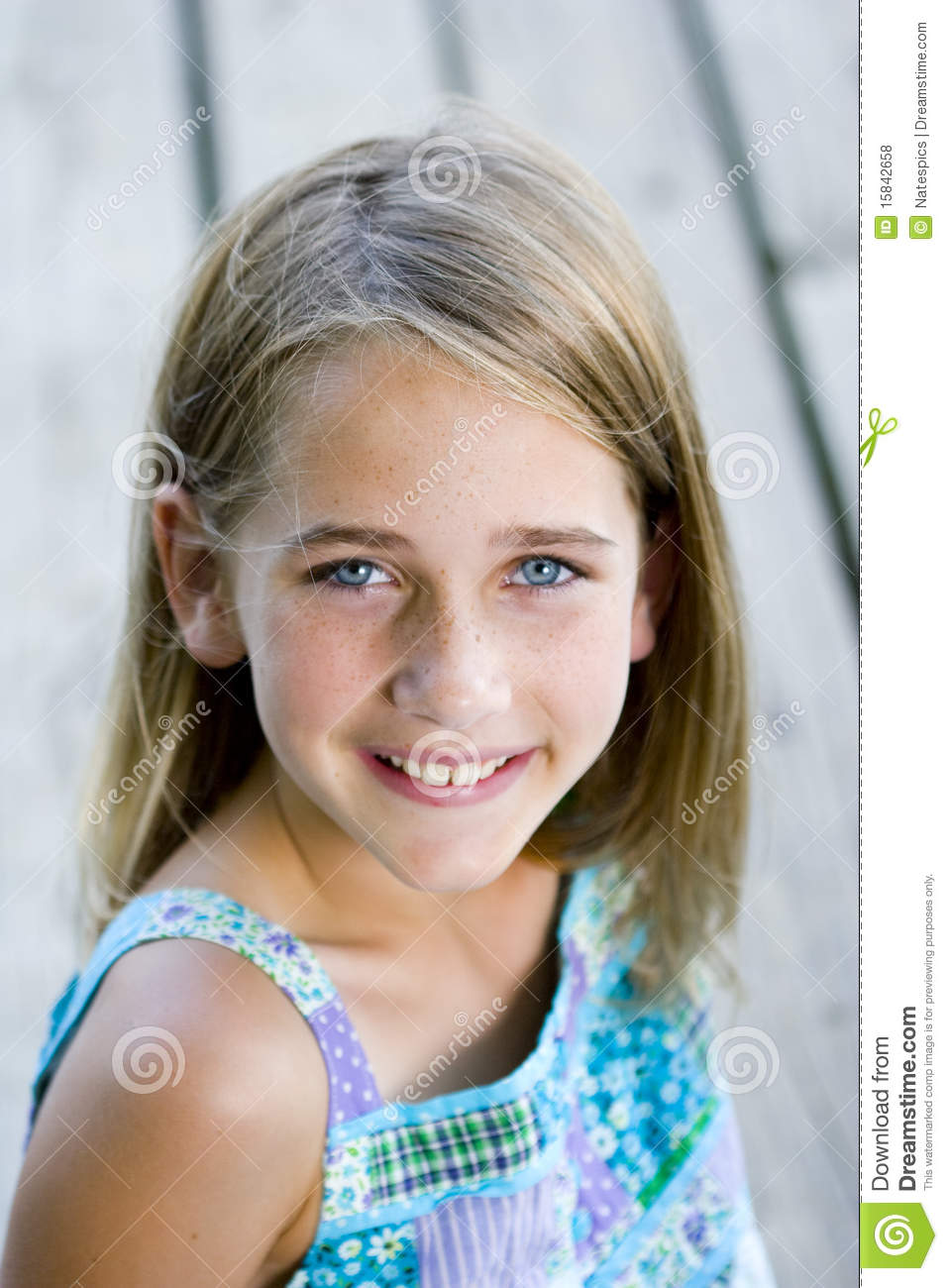 Young Tween Girl Sitting On A Pier Stock Photo - Image of ...