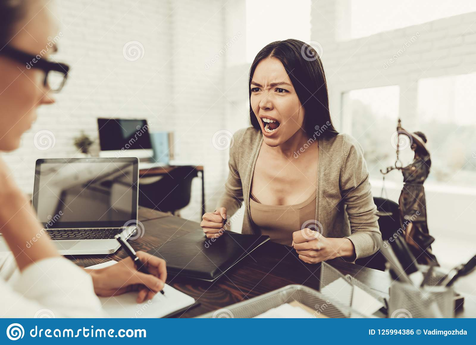 Young Upset Woman In Office With Lawyer In Glasses Stock
