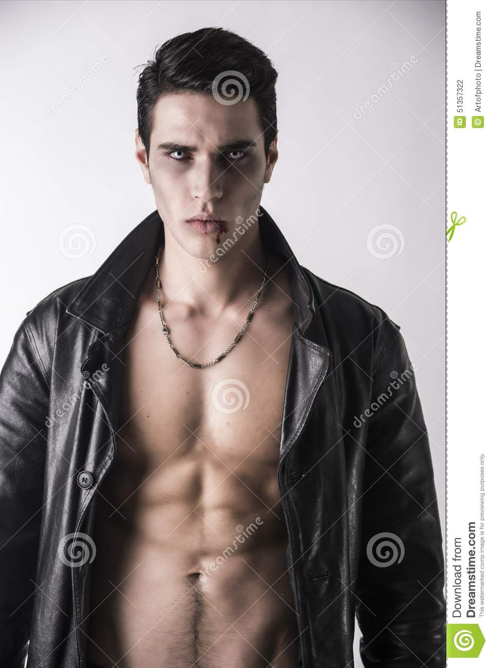 Young Vampire Man In An Open Black Leather Jacket Stock