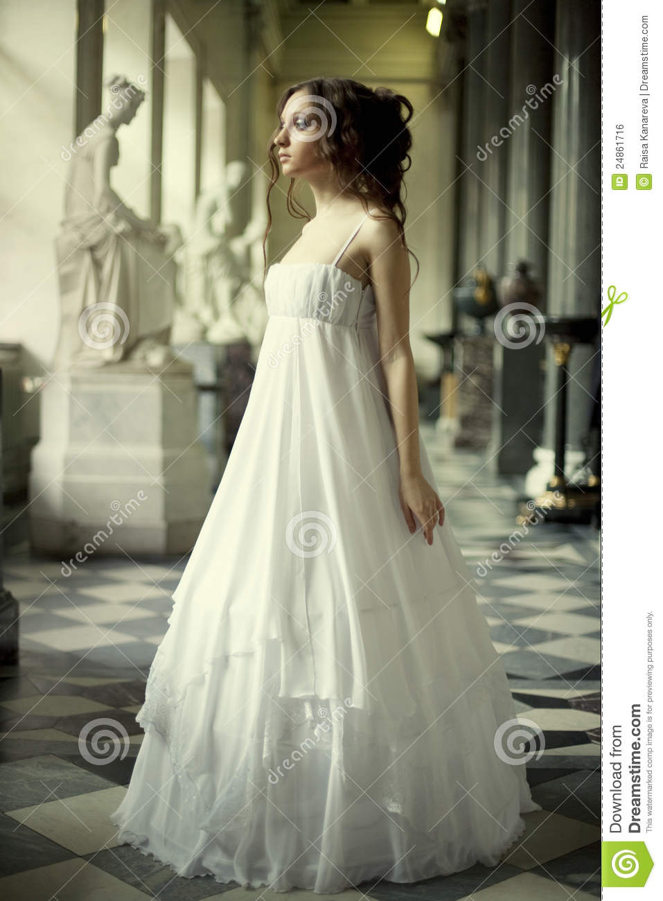 Young victorian lady in white dress