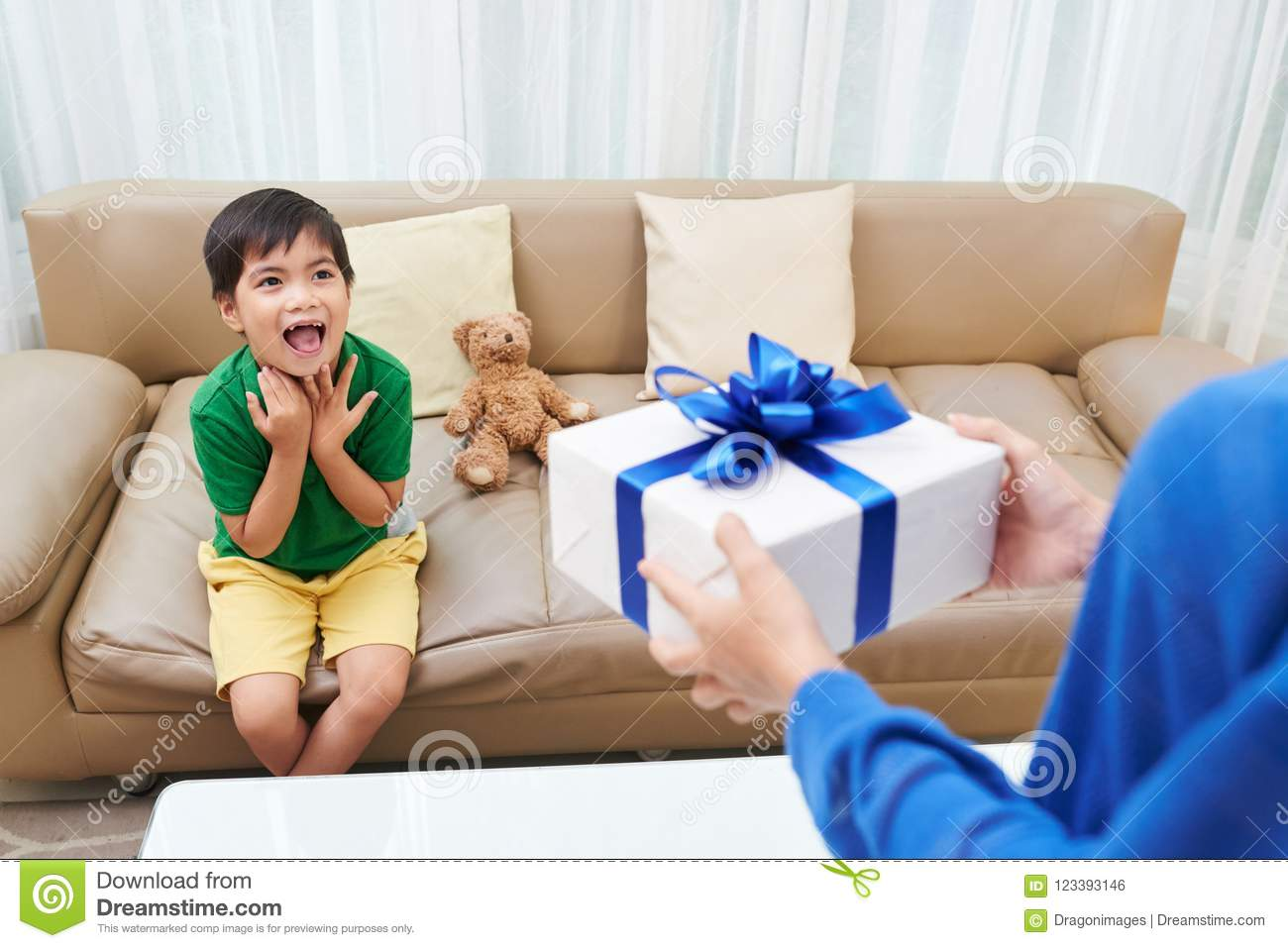 Young Vietnamese Men Excited To Accept Birthday Gift From His Mother