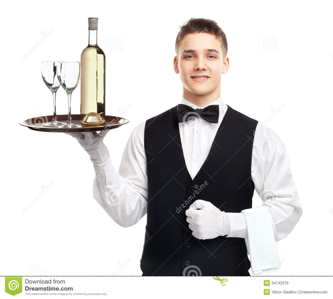 Portrait of young happy smiling waiter with bottle of white wine and ...
