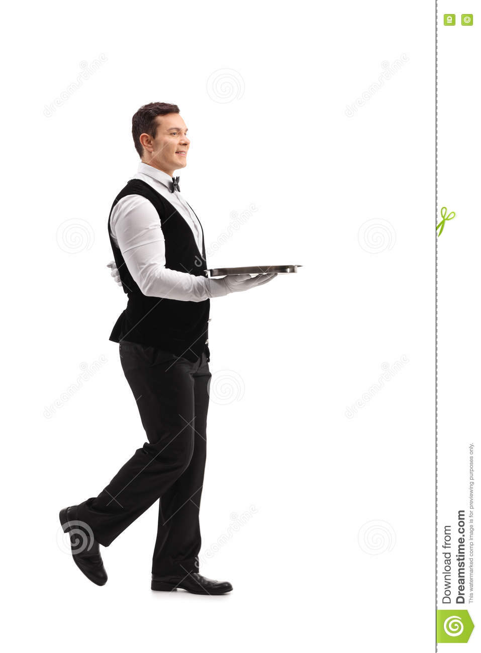 Young waiter walking with an empty tray