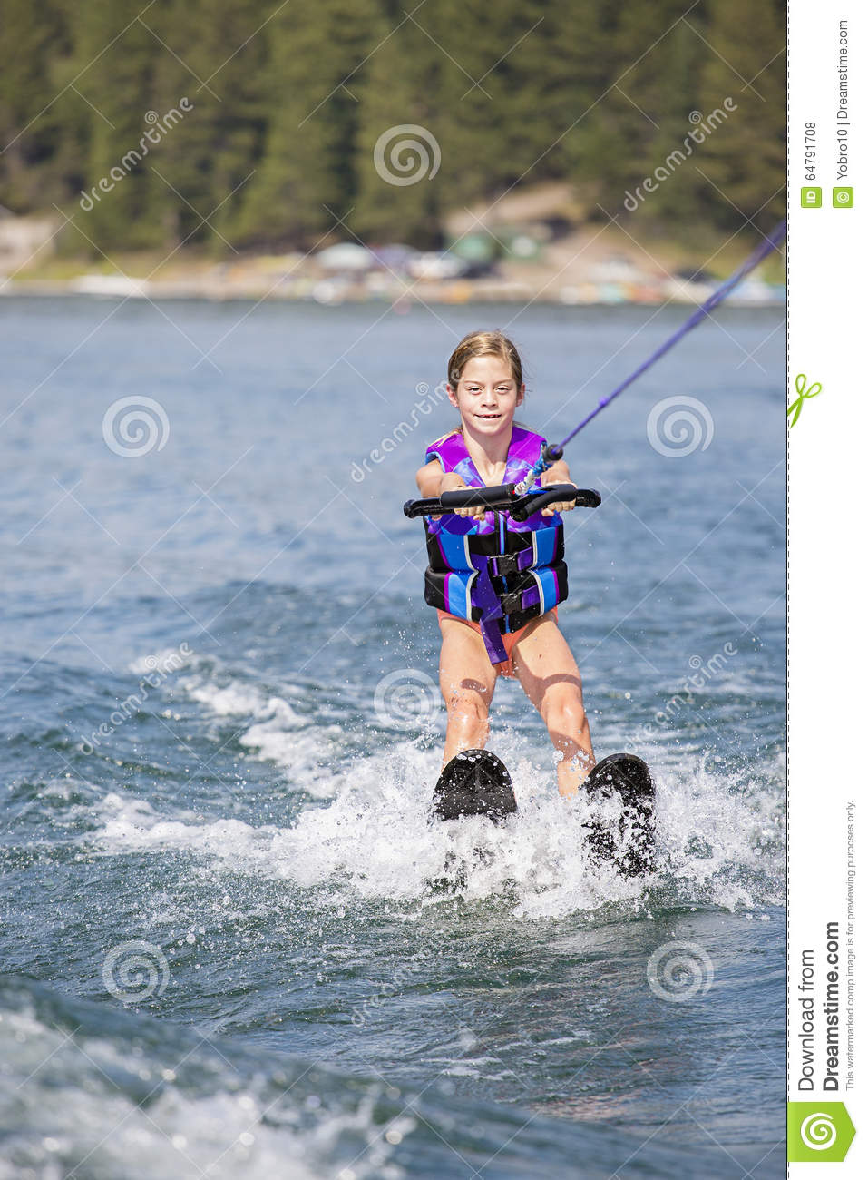 Young Waterskier on a beautiful scenic lake