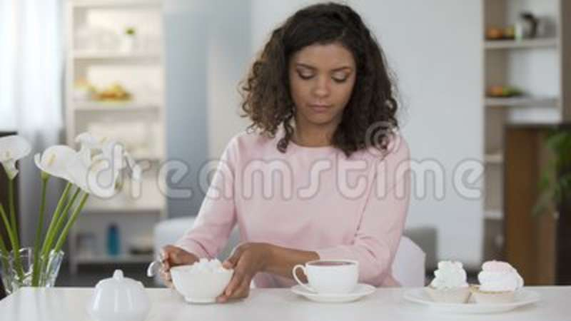 Young Woman Adding Too Much Sugar In Tea Cup Unhealthy Lifestyle Diabetes Stock Video