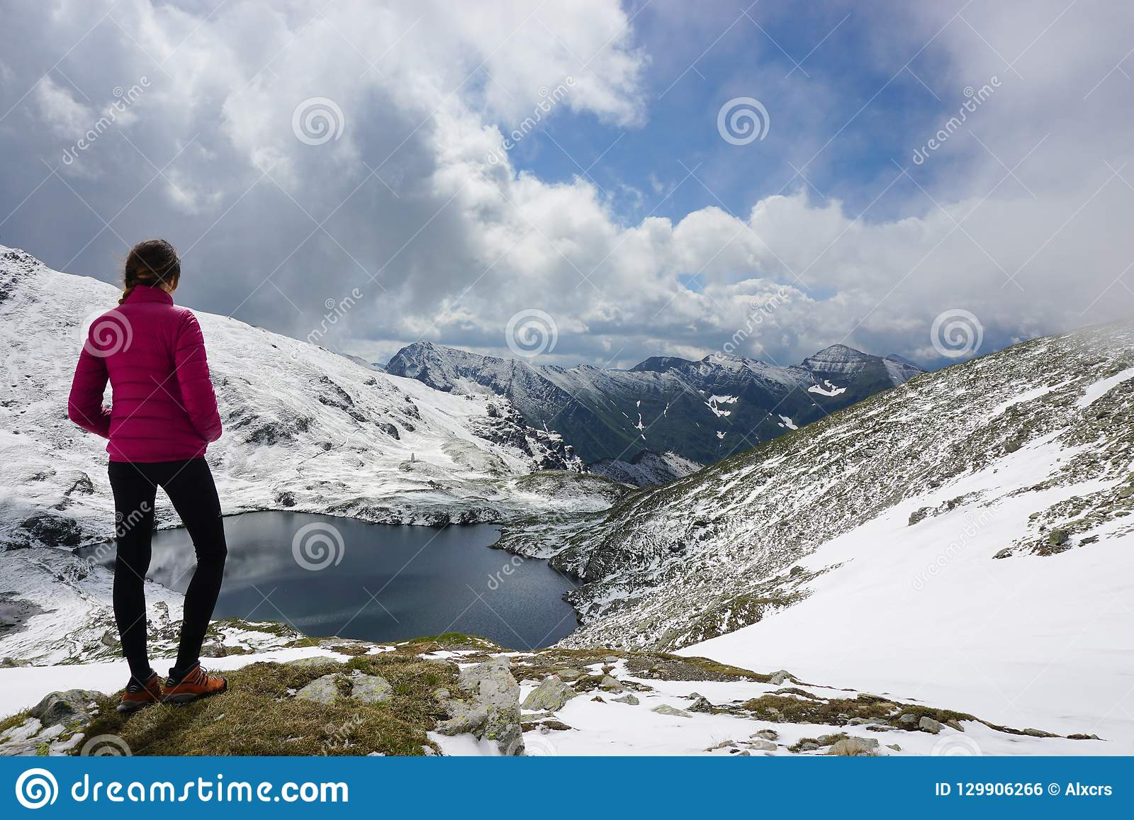 Young woman admiring the view in the mountains
