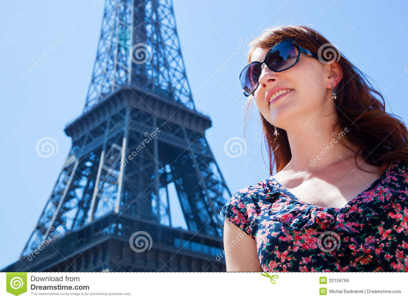Young woman against eiffel tower paris france royalty free stock