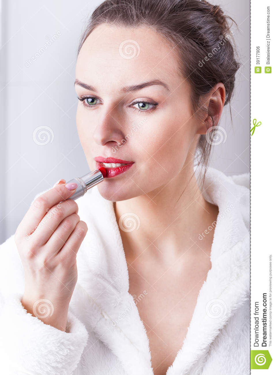 Young Woman Apply Lipstick Stock Image