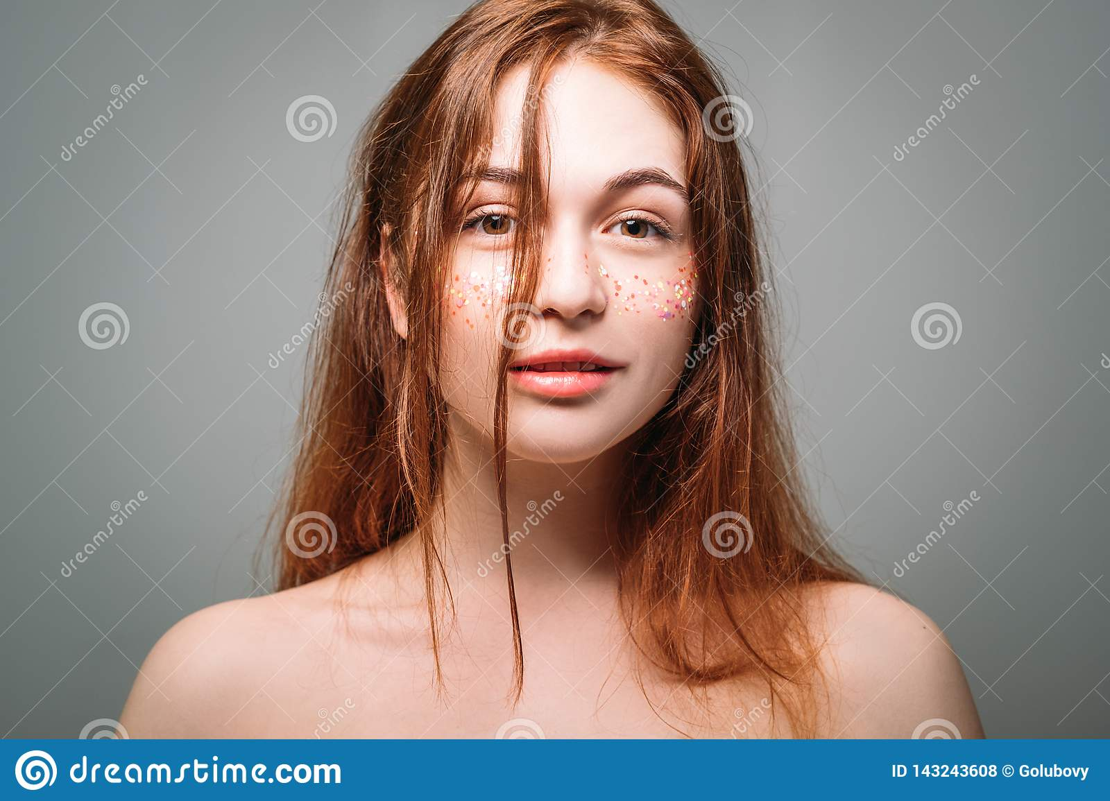 Young woman awakening beautiful naked shoulders