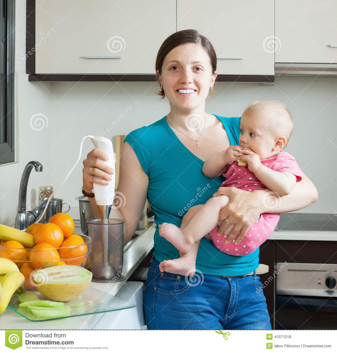 Young Woman With Baby Girl In Kitchen Stock Photo - Image of ...