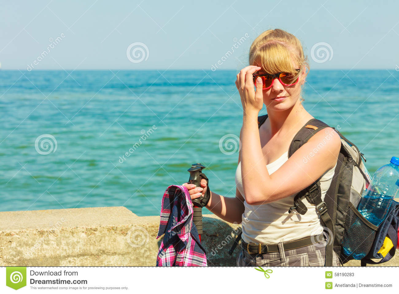 Young Woman With Backpack Hiking On Sea Coast Stock Image - Image of ... 9ca6f22bb7d86