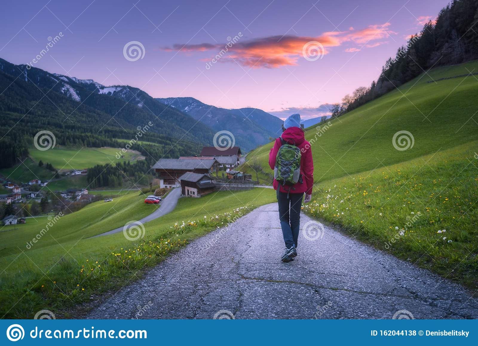 Young Woman And Teenage Girl Running Along Rural Road Rear
