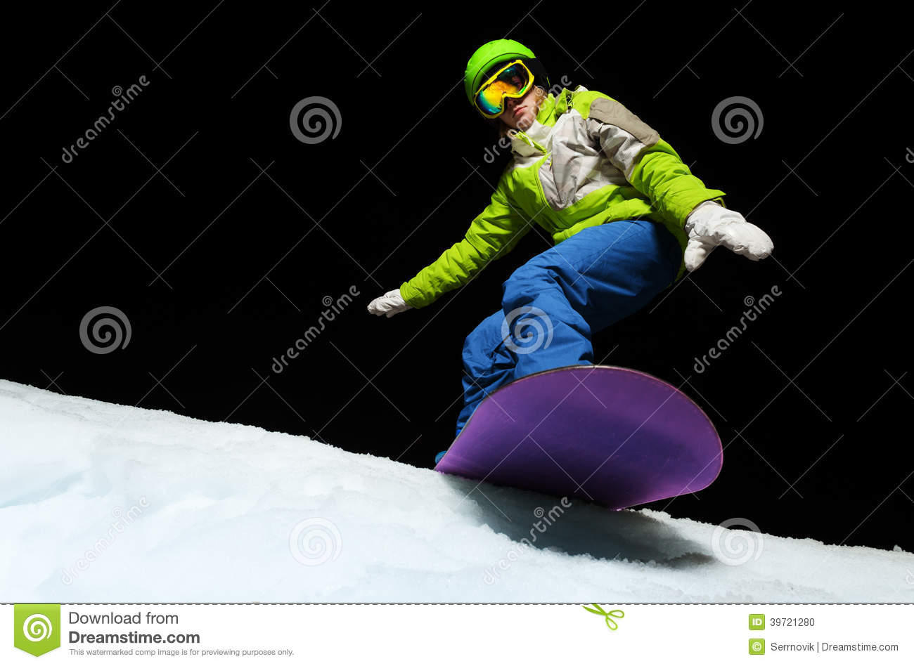 9579c698e627 Portrait of young woman wearing ski mask balancing with hands on snowboard  and ready to slide down at night